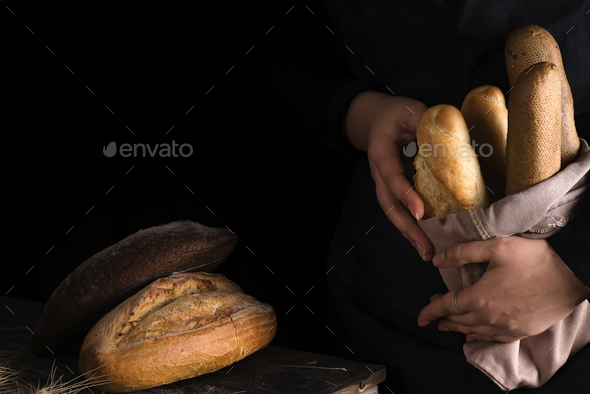 Lots of different bread sorts, wrapped in craft paper. - Stock Photo - Images