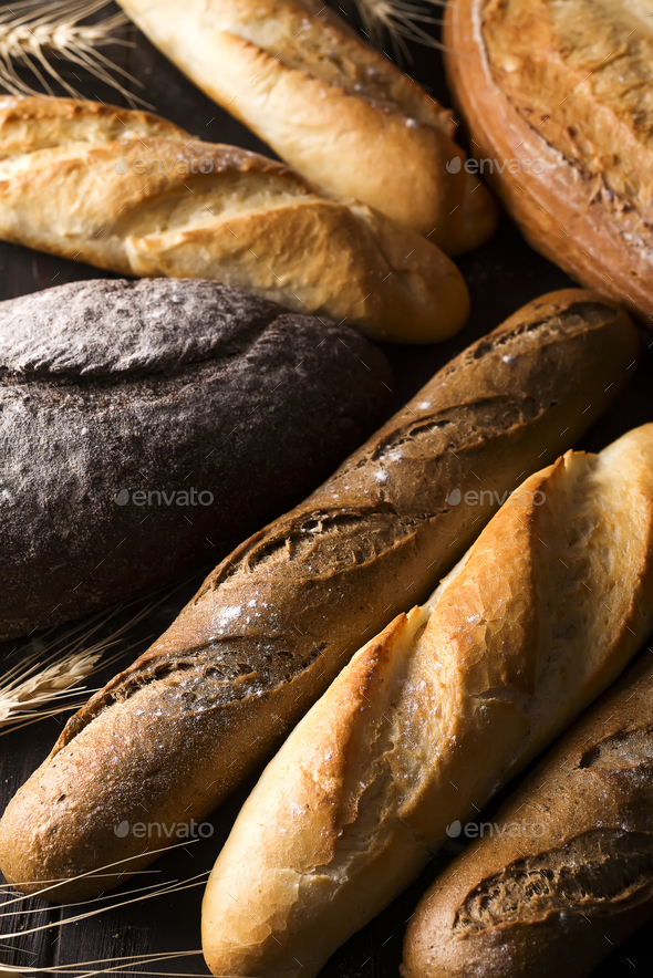 Fresh baked bread background, variety of different kind of breads, food industry - Stock Photo - Images