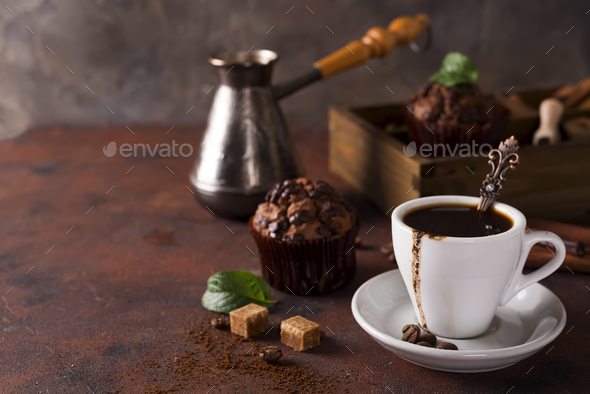 Cup of coffee with cooffee beans, wooden box with grains of coffee and spices, cupcake - Stock Photo - Images