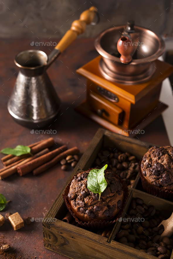 Chocolate muffins on a wooden box with grains of coffee and spices, - Stock Photo - Images