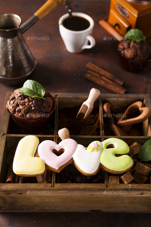 Cup of coffee with cooffee beans, wooden box with grains of coffee and spices, cookies - Stock Photo - Images