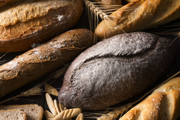fresh bread and wheat on the wooden - Stock Photo - Images