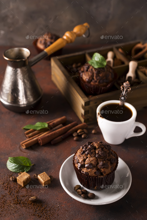 Chocolate muffins with a cup of coffee on the table - Stock Photo - Images