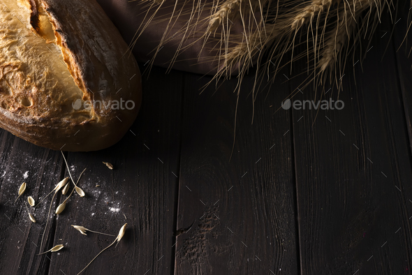 Bakery - gold rustic crusty loaves of bread and buns on black background. - Stock Photo - Images