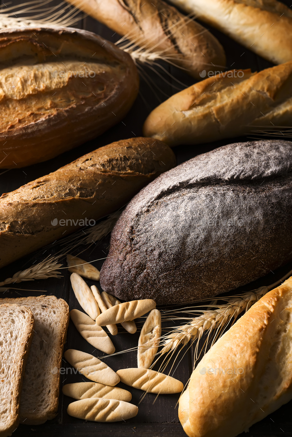 Top view of different kinds of bread with cereals isolated - Stock Photo - Images