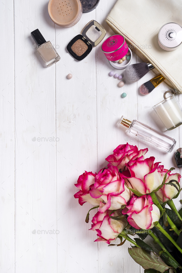 Women cosmetics and fashion items on white wooden background - Stock Photo - Images