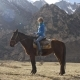 Girl on a Horse in the Mountains - VideoHive Item for Sale
