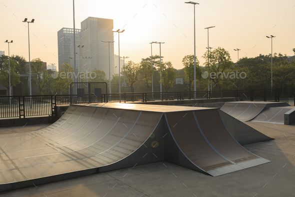 modern skatepark in the sunrise - Stock Photo - Images
