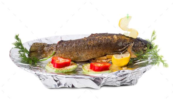 Delicious grilled trout with vegetables. - Stock Photo - Images