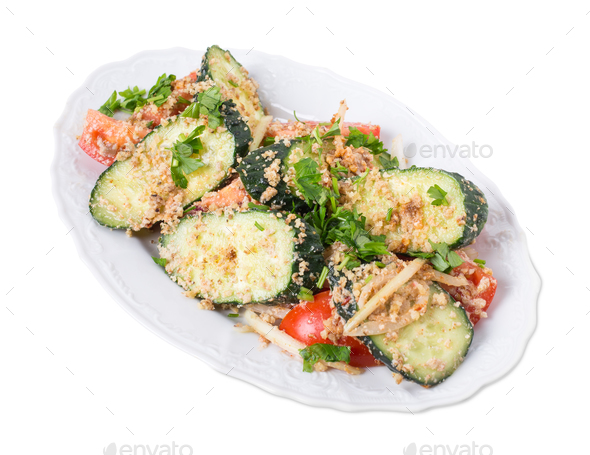 Fresh tomato salad with walnuts and cucumbers. - Stock Photo - Images