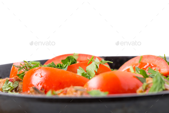 Delicious stewed pork fillet with fresh tomatoes. - Stock Photo - Images
