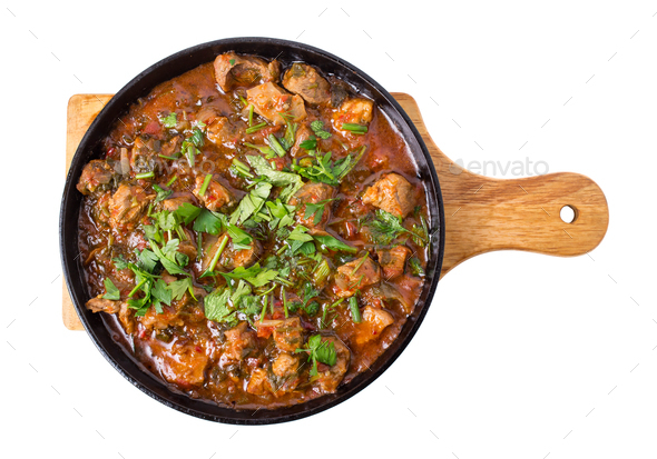 Delicious stewed lamb fillet with tomatoes. - Stock Photo - Images