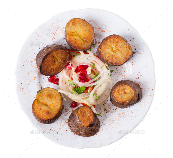 Delicious baked potatoes with red pepper. - Stock Photo - Images