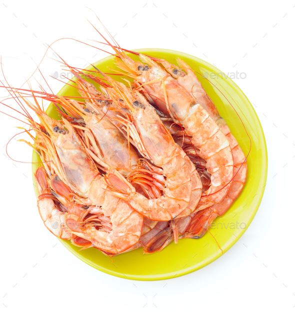 plate of raw prawns on white background - Stock Photo - Images