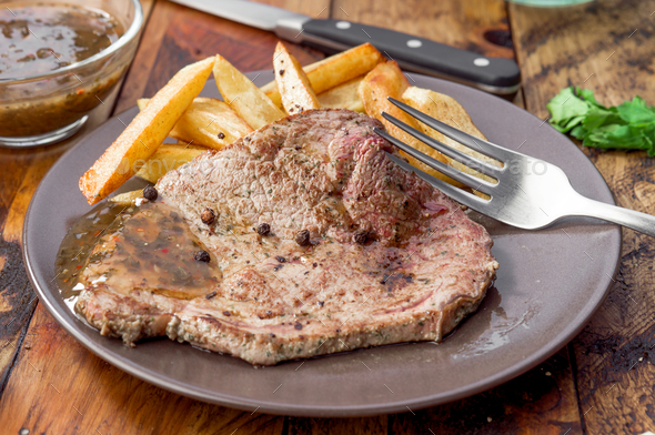 grilled beef steak with chips - Stock Photo - Images