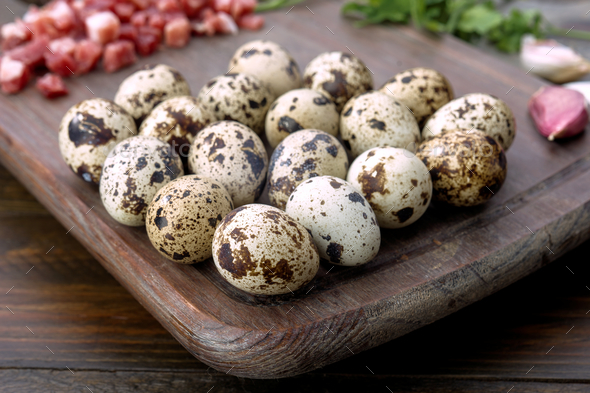 raw quail eggs on wood with other cooking ingredients - Stock Photo - Images