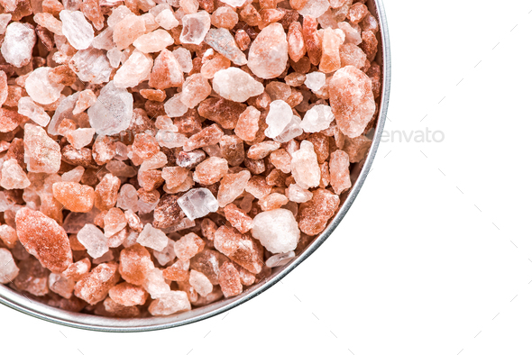Himalayan salt cristals seeds in pot isolated on white - Stock Photo - Images