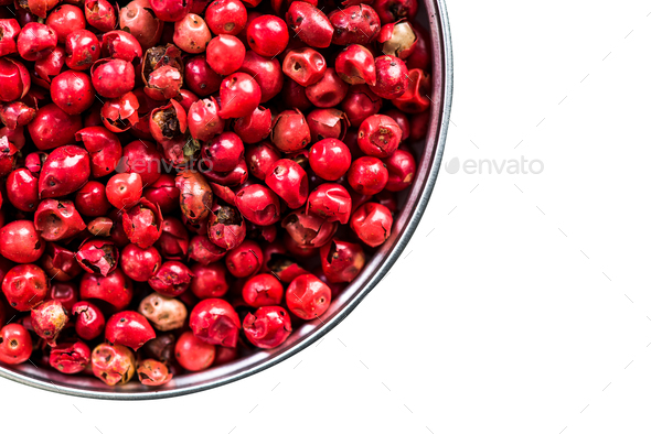 Red pepper seeds in pot isolated on white - Stock Photo - Images
