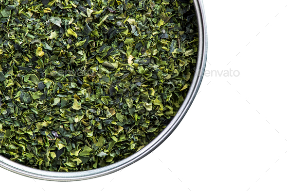 Aonori seaweed flakes in pot,isolated on white - Stock Photo - Images