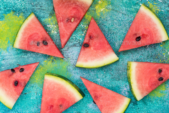 Watermelon slices on vibrant concrete slate - Stock Photo - Images