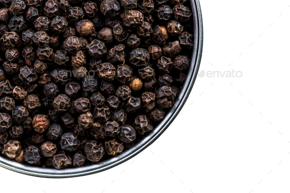 Black pepper seeds in pot isolated on white - Stock Photo - Images