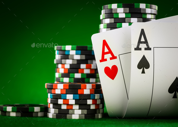 Stack of chips and two aces on the table on the green baize - Stock Photo - Images