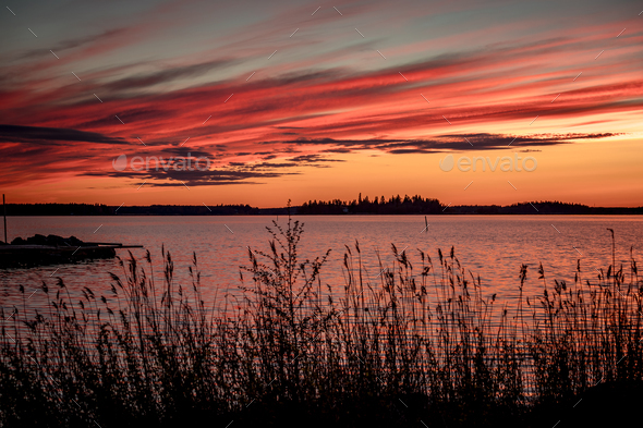 Crimson sunset on the background of the Gulf of Bothnia - Stock Photo - Images