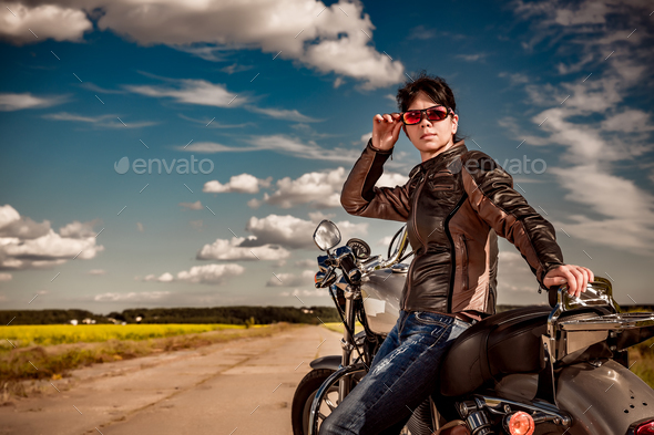 Biker girl on a motorcycle - Stock Photo - Images