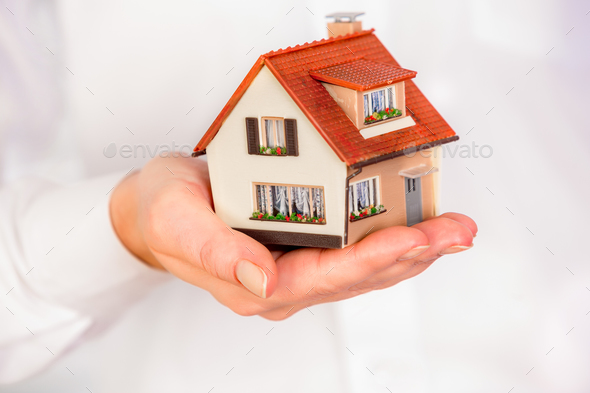 House in human hands - Stock Photo - Images
