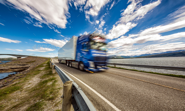 Truck rushes down the highway in the background Atlantic Ocean R - Stock Photo - Images