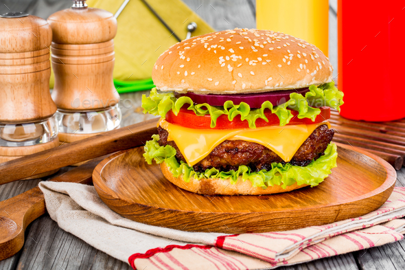 Tasty and appetizing hamburger cheeseburger - Stock Photo - Images