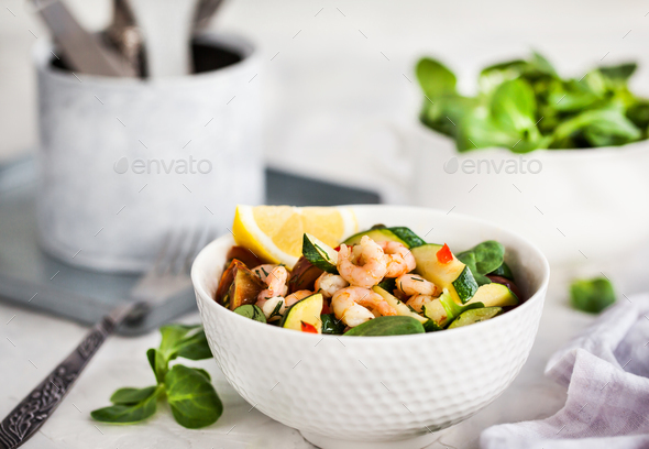 Shrimps and zucchini warm salad - delicious healthy food - Stock Photo - Images