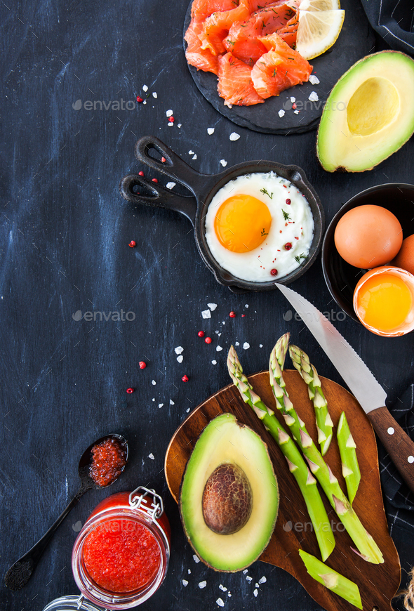 Top view of breakfast table with fried eggs, avocado, asparagus, - Stock Photo - Images