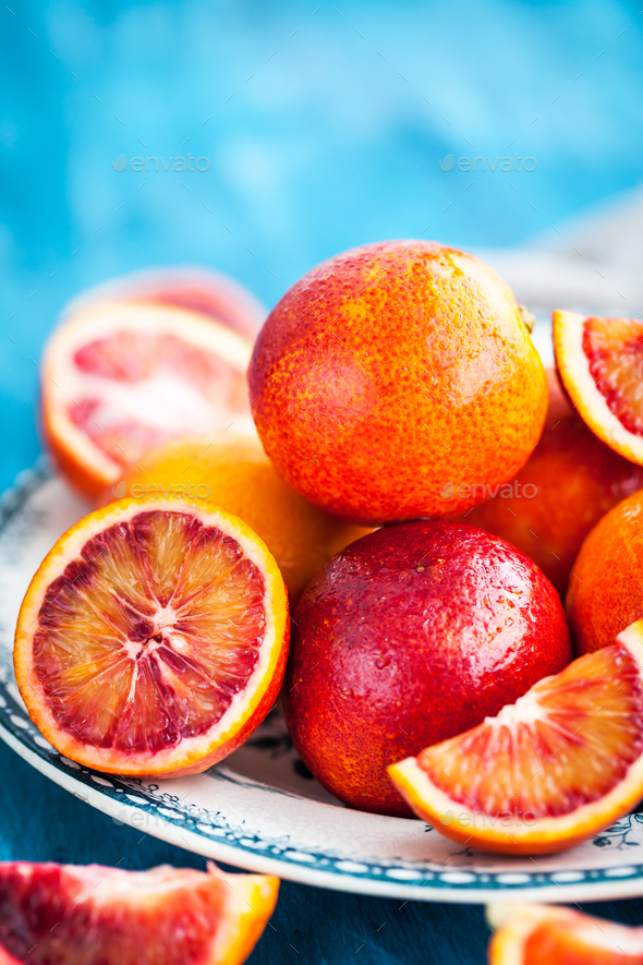 Sliced and whole fresh ripe juicy sicilian blood oranges - Stock Photo - Images