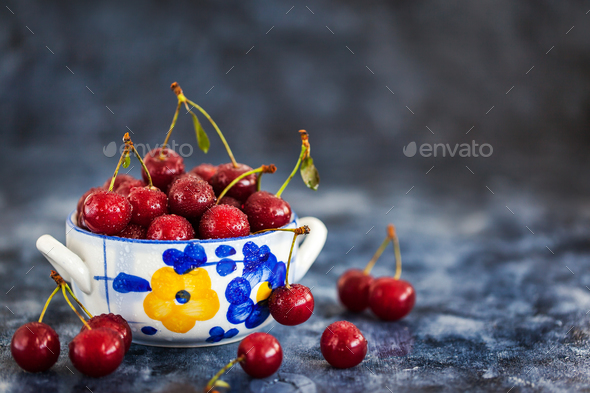 Fresh wet sour cherry in a bowl - Stock Photo - Images