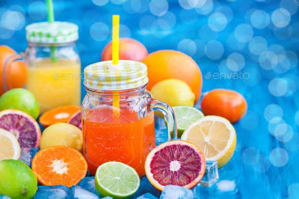 Citrus vitamin juice with fresh fruits around - Stock Photo - Images