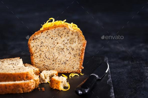 Lemon and poopy seeds pound cake on dark background - Stock Photo - Images
