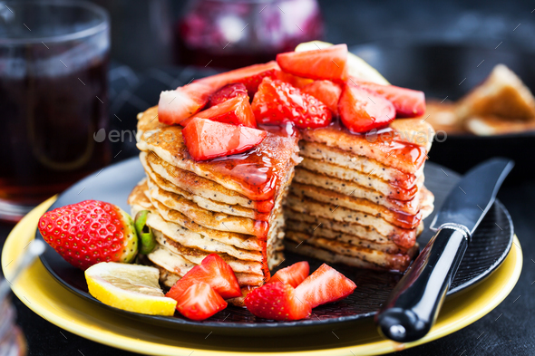 Stack of freshly prepared lemon poppy seed  pancakes with fresh - Stock Photo - Images