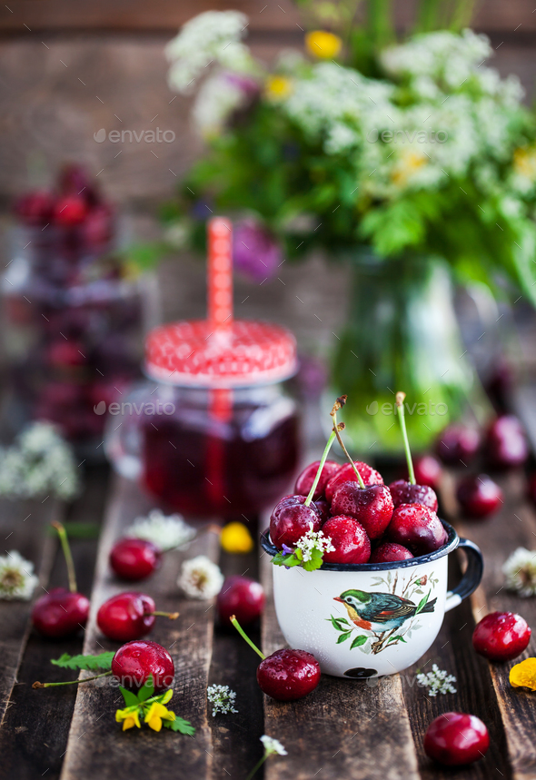 Fresh wet cherry in enamel metal mug - Stock Photo - Images