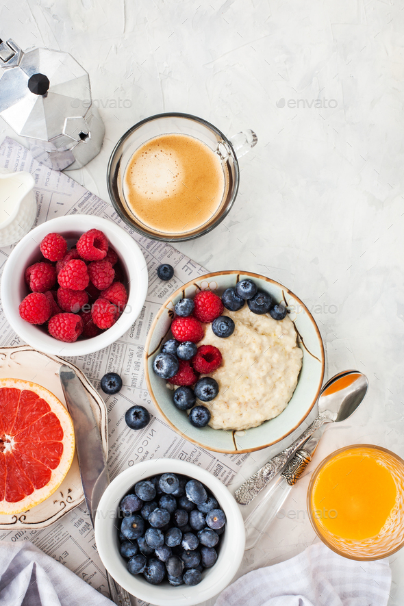 Healthy breakfast table with oatmeal porridge,  fresh berries an - Stock Photo - Images