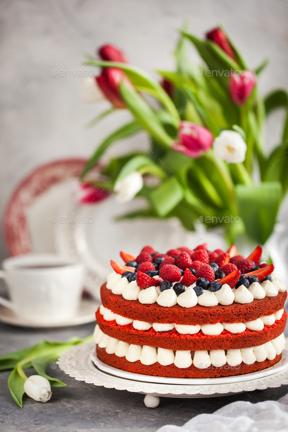 Delicious homemade red velvet cake decorated with cream and fres - Stock Photo - Images