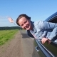 Happy Young Woman Going on a Road Trip Leaning Out of Window - VideoHive Item for Sale