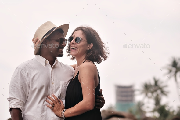 Lovely couple on tropical beach. Concept of just married lovers. - Stock Photo - Images