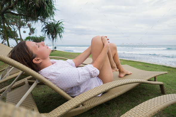 caucasian woman relaxing in chair near indian ocean in Srilanka. - Stock Photo - Images