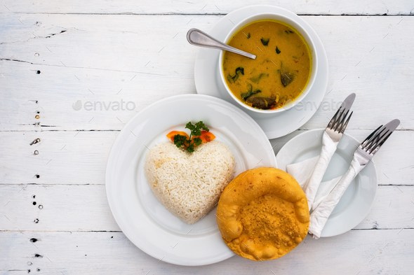Fish curry with rice. - Stock Photo - Images