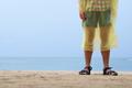 man on ocean or sea coast in rain coat - PhotoDune Item for Sale