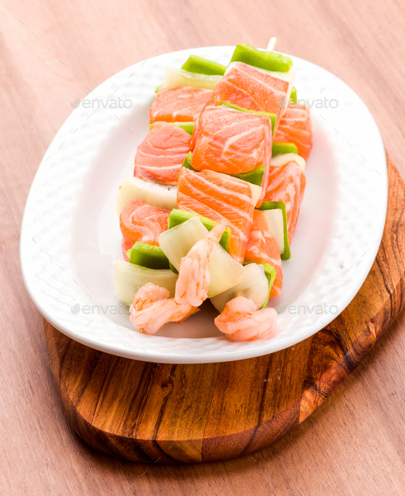 raw skewer of salmon prawns and vegetables - Stock Photo - Images