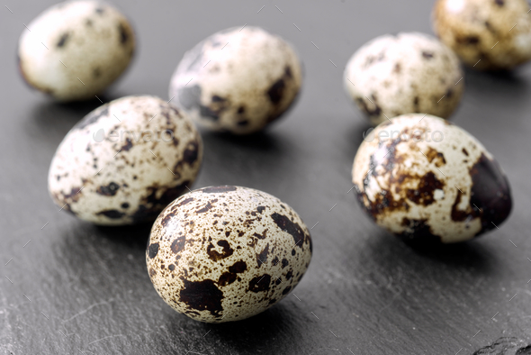 raw eggs of quail on stone - Stock Photo - Images
