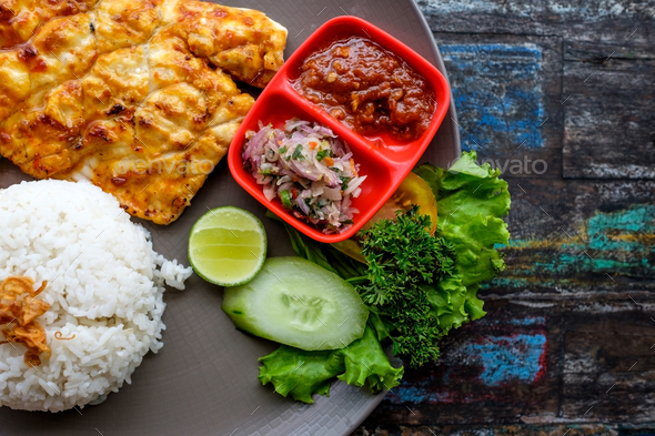 Thai Food Fried fish curry powder with rice - Stock Photo - Images