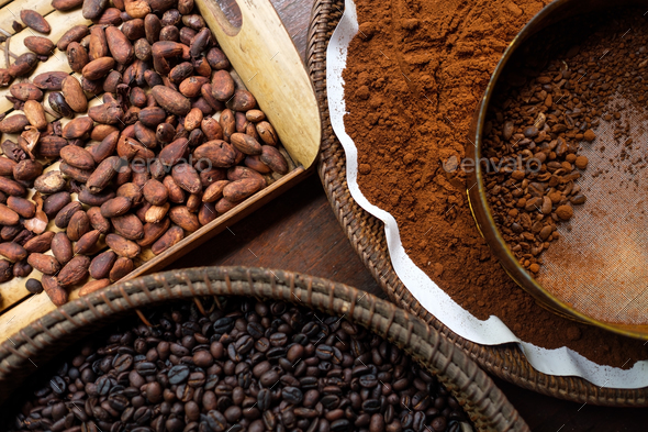 Different types of coffee beans on the plates - Stock Photo - Images